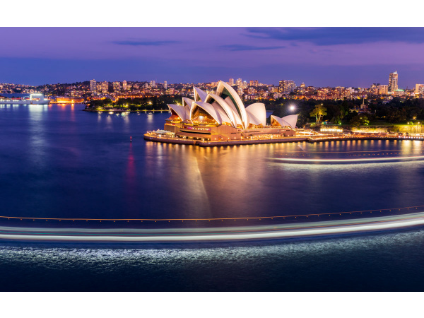 A ferry boat passes in front of the Sydney Opera House