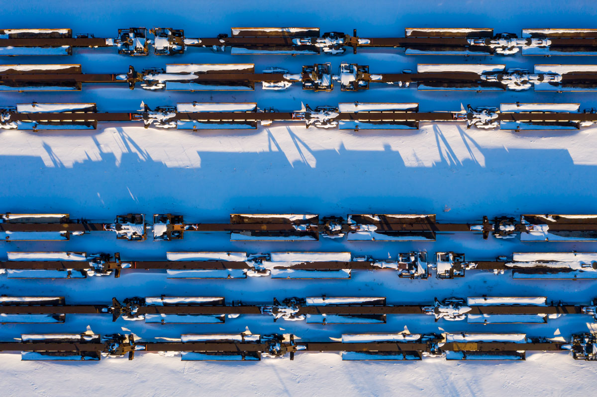 Train cars covered in snow outside of Chicago